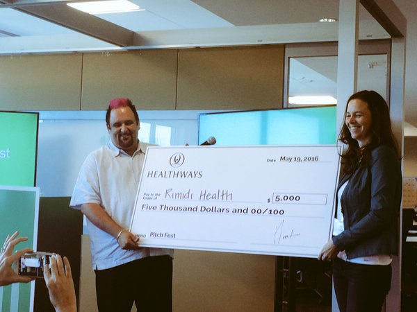 Dr. Lucie Ide, is presented with $5,000 for winning the HILL Pitch Fest in Tennessee.