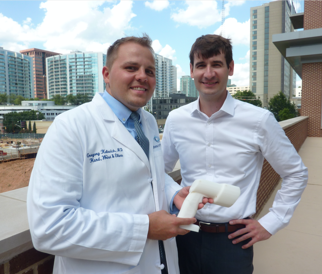 Dr. Greg Kolovich, an orthopedic hand and micro-surgeon (left), stands with business partner Evan Ruff. Kolovich is the founder of Micro C, a Savannah-based company that developed an all-in-one, hand-held X-ray and digital camera for surgeons and physicians treating disorders of the extremities. Ruff is CEO and a third partner, Kirby Sisk, is chief operating officer. Kolovich, Ruff, and Sisk are all graudates of Georgia Tech. (Photo credit: Péralte C. Paul)