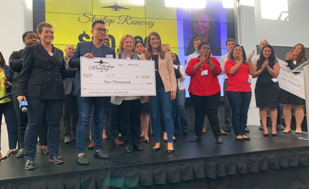 Tony Hoang (second from left) holds his $10,000 prize from the Startup Runway Foundation's Spring Showcase event on May 2, 2019. (Photo: Special)